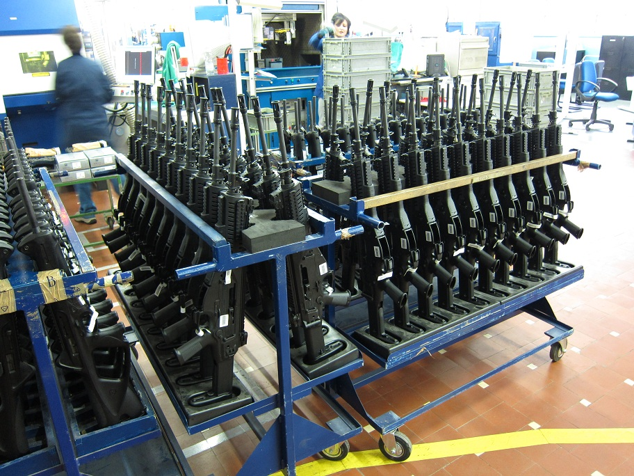 Racks of Beretta automatic firearms at the Beretta factory